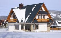 Jak przygotować do zimy pokrycie dachowe i rynny?